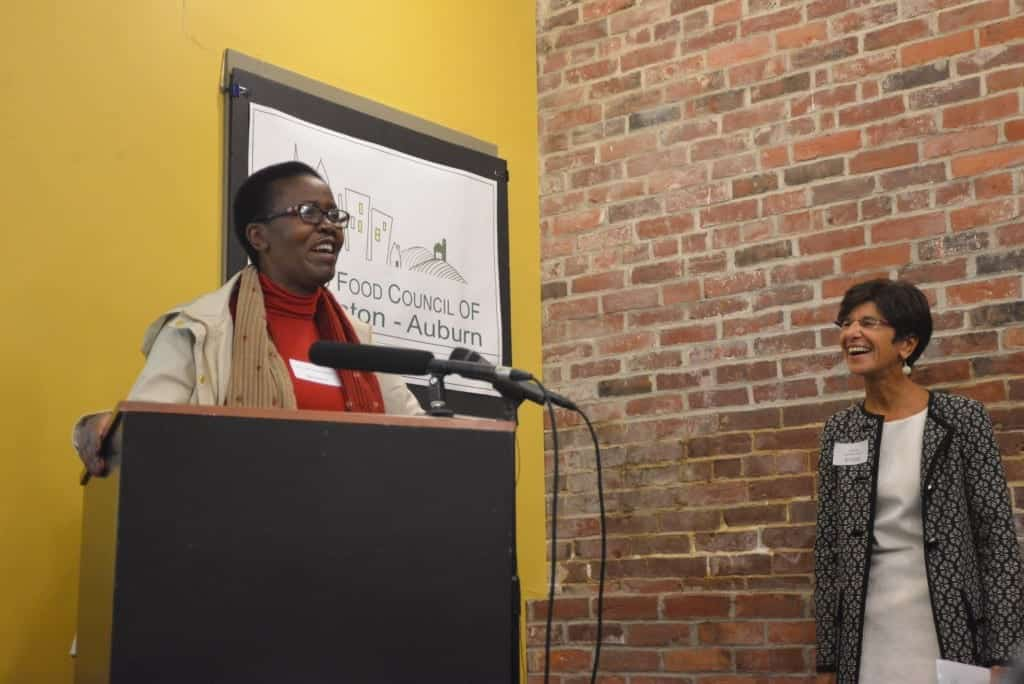 Dr. Lindiwe Majele Sibanda and Catherine Lee share a laugh at the Lewiston-Auburn Community Food Charter launch event. Sibanda and Lee, of Maine Law's Justice for Women Lecture Series, join the Good Food Council of Lewiston-Auburn to celebrate the launch.
