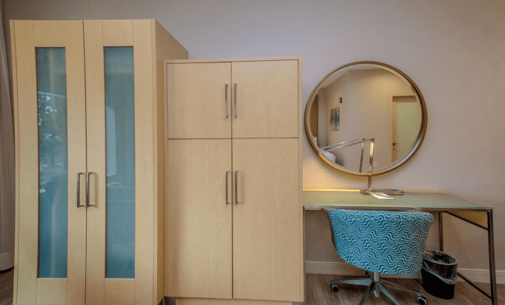 Chandler Luxury Studio Suite Armoire and desk with mirror on the wall