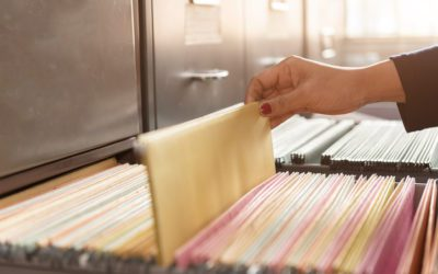 How should employee files be organized?